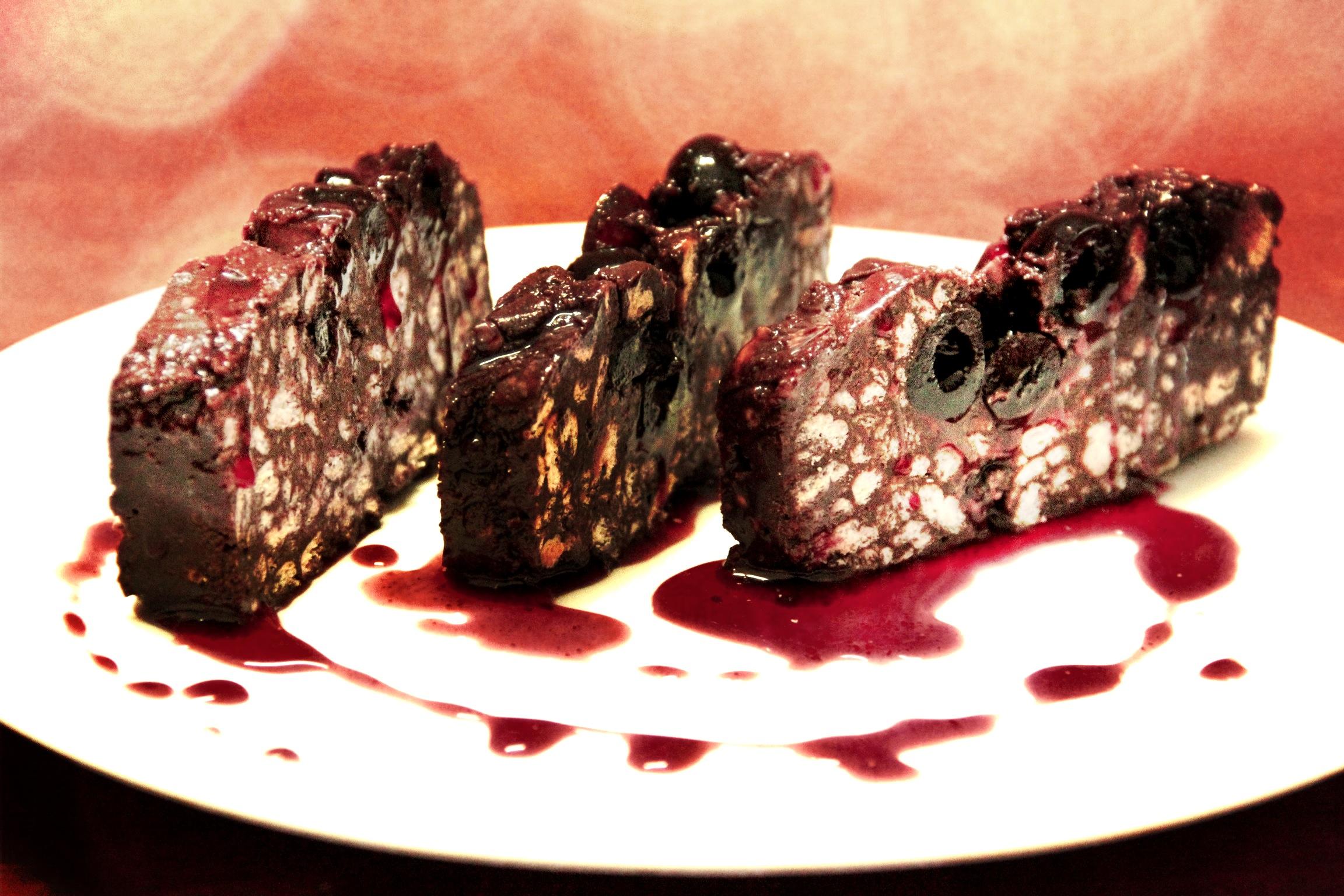 Chocolate salami with sour cherries sauce.. | urbanzip
